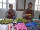 Ladies making dolls