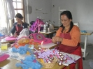 Ladies making dolls and bags