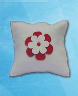 White cushion with center flower